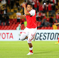 BOGOTA-COLOMBIA-21-02-2013 . John Valencia  del Independiente Santa Fe  de Colombia  celebra su gol en contra  del equipo Deportes Tolima  , también de Colombia  , encuentro  por el  grupo cinco  de  la ronda de clasificación de la Copa Bridgestone Libertadores . John Valencia of Colombia's Independiente Santa Fe celebrates his goal against the team Deportes Tolima, also from Colombia, meeting by the group five of the qualifying round of the Copa Libertadores Bridgestone.  ( Photo / VizzorImage / Felipe Caicedo / Staff