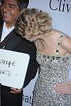 BEVERLY HILLS, CA. - January 30: George Lopez and Taylor Swift arrive at the 52nd Annual GRAMMY Awards - Salute To Icons Honoring Doug Morris held at The Beverly Hilton Hotel on January 30, 2010 in Beverly Hills, California.