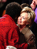 Washington, D.C. - February 2, 2005 -- United States Senator Hillary Rodham Clinton (Democrat of New York) is hugged by United States Representative Stephanie Tubbs Jones (Democrat of Ohio) as she arrives in the United States House of Representatives chamber for the State of the Union Address in the United States Capitol in Washington, D.C. on February 2, 2005.  <br /> Credit: Ron Sachs / CNP