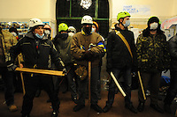 Protesters prepare for the assault inside the occupied  townhall. Tonight the  police is expected to forcedly evacuate the streets from the protesters blocking all the government buildings. Kiev. Ukraine.