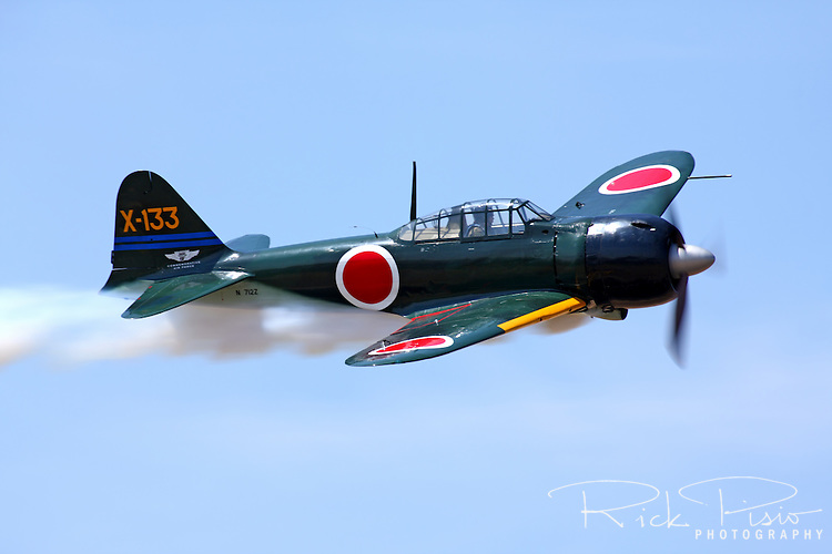 A Mitsubishi built A6M3 Zero fighter in flight during an air show at Madera, California, in May of 2009. One of three still flying in the world today the aircraft was recovered from New Guinea in 1991, restored, and returned to flying condition in 1998. The aircraft is flown regularly by the Southern california Wing of the Commemerative Air Force.