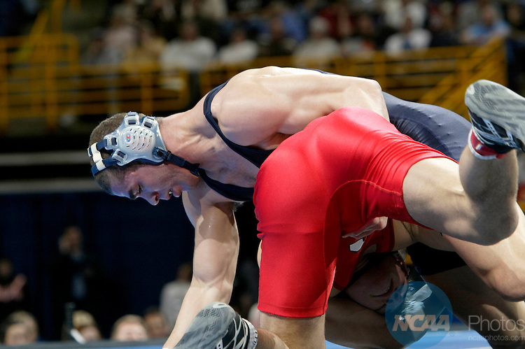 17 MARCH 2005: Greg Jones (top, in navy) of the University of West Virginia wrestles with Tyler Baier (red) of Cornell University during their 184 pound championship match at the 2005 NCAA Division 1 Men's Wrestling Championships at Savvis Center in St. Louis, MO. Jones defeated Baier 5-3 for the championship title.   Mark Buckner/NCAA Photos