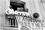 Mexican poet Oscar Oliva, journalist Fernando Benitez, Arturo Warman and writer Carlos Monsivais look at the popular assembly held by Coalicion Obrera campesina Estudiantil del Istmo (COCEI) to defend the leftist municipality government on August 7, 1983 at the main plaza of Juchitan, Oaxaca.  © Photo by Heriberto Rodriguez