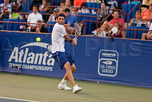 July 24, 2010:  ATP Atlanta Tennis Championship:  Mardy Fish returns a backhand in the semifinals match  against Andy Roddick at the Atlanta Athletic Club in Johns Creek, GA on July 23, 2010.