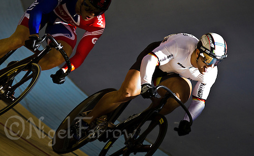 19 FEB 2012 - LONDON, GBR - Germany's Robert Foerstemann (GER) (right) leads Great Britain's Sir Chris Hoy (GBR) during their Men's Sprint semi final at the UCI Track Cycling World Cup, and London Prepares test event for the 2012 Olympic Games, in the Olympic Park Velodrome in Stratford, London, Great Britain .(PHOTO (C) 2012 NIGEL FARROW)