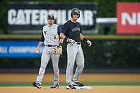 Jake Mueller (6) of the Wake Forest Demon Deacons looks to the home dugout and celebrates after hitting a double against the West Virginia Mountaineers in Game Six of the Winston-Salem Regional in the 2017 College World Series at David F. Couch Ballpark on June 4, 2017 in Winston-Salem, North Carolina.  The Demon Deacons defeated the Mountaineers 12-8.  (Brian Westerholt/Four Seam Images)