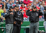 15 May 2016: MLB Umpires communicate with the New York City video crew on a reviewable play between the Miami Marlins and the Washington Nationals at Nationals Park in Washington, DC. The Marlins defeated the Nationals 5-1 in the final game of their 4-game series.  Mandatory Credit: Ed Wolfstein Photo *** RAW (NEF) Image File Available ***