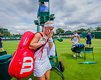 London, England, 4 th July, 2017, Tennis,  Wimbledon, Kiki Bertens (NED) leaves the court, she just lost to Sorana Cirstea (ROU) (background)<br /> Photo: Henk Koster/tennisimages.com
