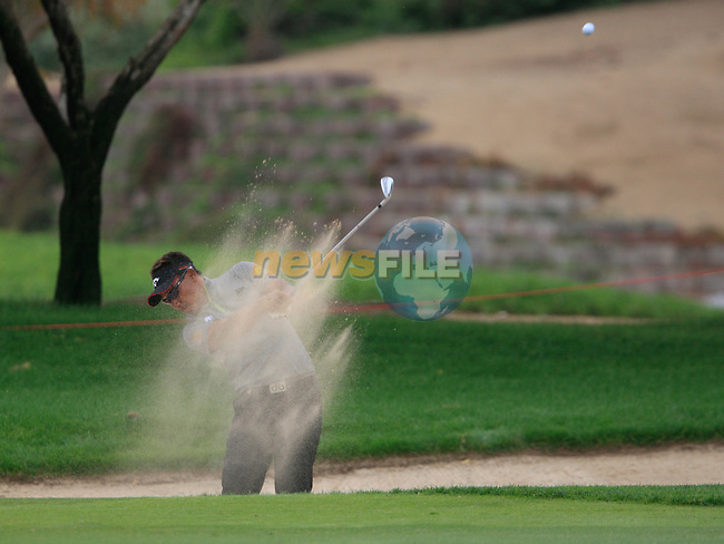 Thongchai Jaidee plays his 2nd shot from a fairway bunker on the11th hole during Thusday Day 1 of the Abu Dhabi HSBC Golf Championship, 20th January 2011..(Picture Eoin Clarke/www.golffile.ie)