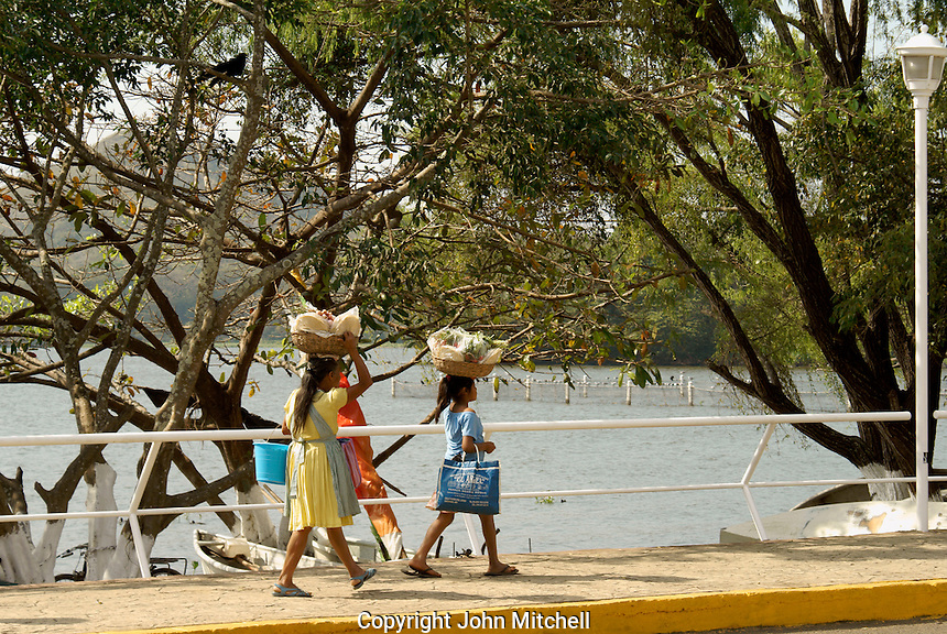 Woman and girls carrying baskets on their heads, Catemaco, Veracruz, Mexico