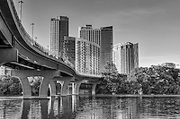 The Pfluger Bridge on Ladybird Lake in Black and White with the high-rise condos in the background. We took this from below the pedestrian bridge and notice all the people hanging out underneath it. Kayaks and canoes seem to just be sitting under the shade of the bridge, some were jumping into the water, some appeared to be having a picnic.