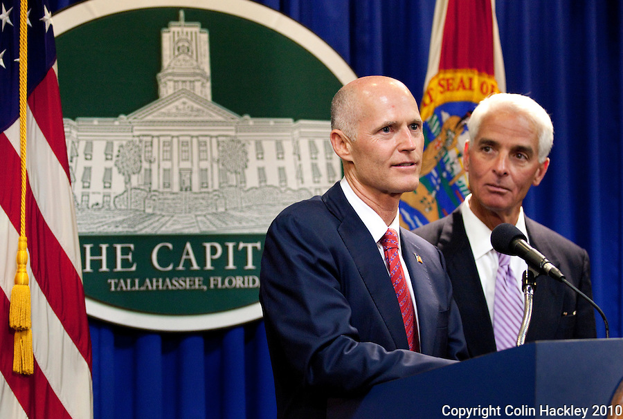 TALLAHASSEE, FLA. 11/9/10-SCOTT-CRIST 110910 CH-Governor-elect Rick Scott, left, is joined by Gov. Charlie Crist  during their news conference Tuesday at the Capitol in Tallahassee...COLIN HACKLEY PHOTO