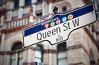 """""""Younge downtown"""" logo are seen on a Queen street West street sign in Toronto April 19, 2010."""