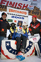 Robert Sorlie w/Lead Dogs 1st Place Under Banner @ Finish Line Iditarod 2005