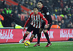 Filip Djuricic of Southampton is challenged by Lazar Markovic of Liverpool - Barclays Premier League - Southampton vs Liverpool - St Mary's Stadium - Southampton - England - 22nd February 2015 - Pic Robin Parker/Sportimage