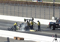 Feb 11, 2018; Pomona, CA, USA; NHRA safety safari rescue crews tend to top fuel driver Brittany Force after crashing during round one of the Winternationals at Auto Club Raceway. Mandatory Credit: Mark J. Rebilas-USA TODAY Sports