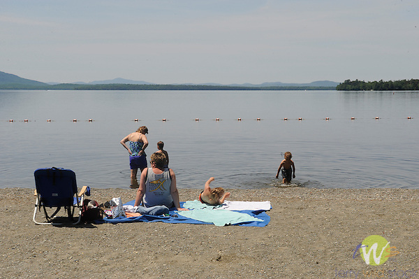 Lily Bay State Park Beach, Moosehead Lake. Family relaxing on beach.