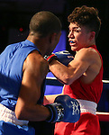 Leroy Davila, left, and Nico Hernandez compete in the U.S. Olympic Boxing Trials in Reno, Nev., on Wednesday, Dec. 9, 2015. (AP Photo/Cathleen Allison)