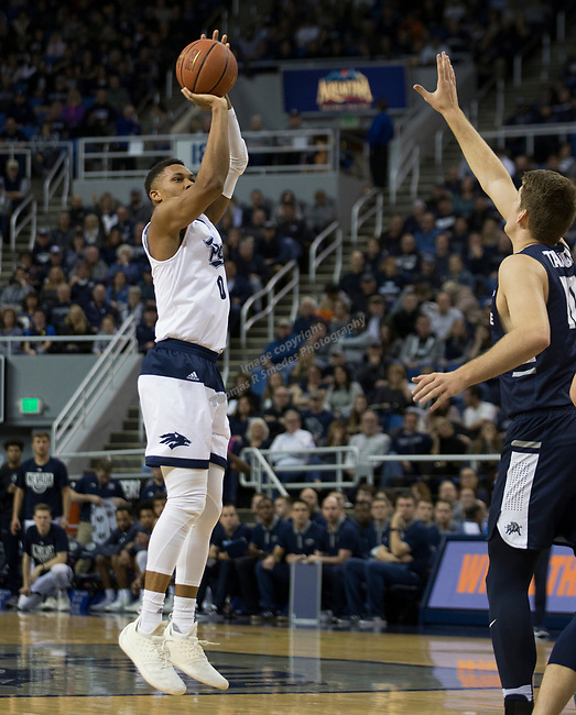 Nevada forward  Tre'Shawn Thurman (0) takes a jump shot against Utah State in the first half of an NCAA college basketball game in Reno, Nev., Wednesday, Jan. 2, 2019. (AP Photo/Tom R. Smedes)