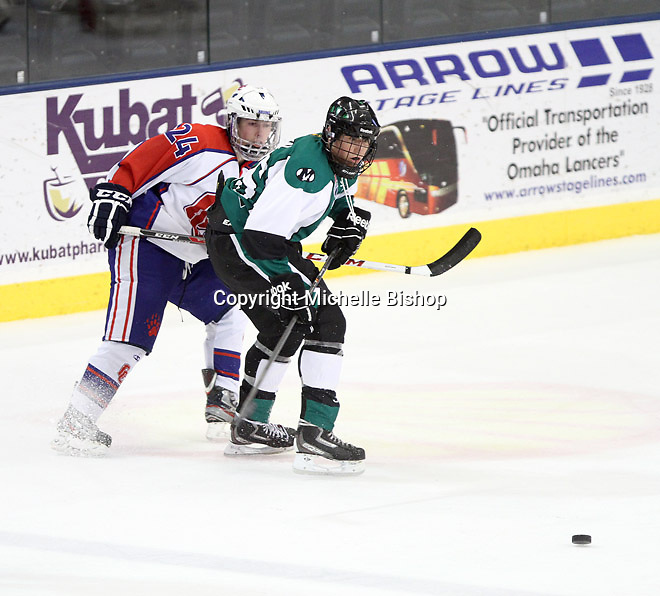 Cherry Creek's Dalton Walker (24) and Medina's Tommy Bogden (No. 35). Cherry Creek (Colorado) beat Medina (Ohio) 5-1 on the third day of pool play during the 2014 High School Hockey National Championship in Omaha on March 28. (Photo by Michelle Bishop)