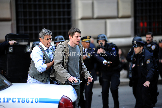 WWW.ACEPIXS.COM<br /> April 11, 2015 New York City<br /> <br /> George Clooney and Jack O'Connell on the film set of 'Money Monster' in the Financial District of Manhattan on April 11, 2015 in New York City. <br /> <br /> Please byline: Kristin Callahan/AcePictures<br /> <br /> ACEPIXS.COM<br /> <br /> Tel: (646) 769 0430<br /> e-mail: info@acepixs.com<br /> web: http://www.acepixs.com