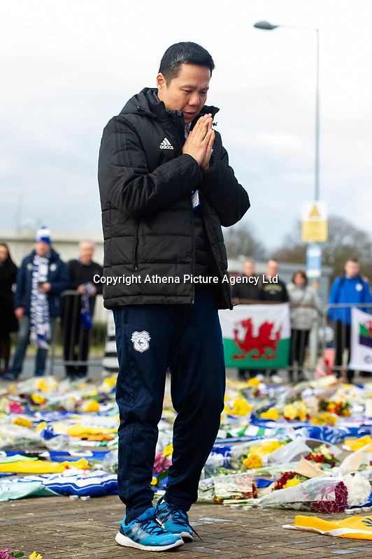Pictured: Ken Choo CEO of Cardiff City pays a tribute for Emiliano Sala laid down outside the Cardiff City Stadium in south Wales, UK. Friday 25 January 2019<br /> Re: Premier League footballer Emiliano Sala was on a flight which disappeared between France and Cardiff.<br /> The Argentine striker was one of two people on board the Piper Malibu, which disappeared off Alderney on Monday night.<br /> Cardiff City FC, signed the 28-year-old from French club Nantes.