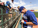 Dodgers' Trent Oeltjen signs autographs before a Cactus League preseason game between the Dodgers and the A's in Scottsdale, Ariz., on Wednesday, March 7, 2012. The game ended 3-3..Photo by Cathleen Allison