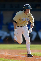 Evan Ocheltree #4 of the Wake Forest Demon Deacons hustles down the first base line as he legs out a triple versus the Duke Blue Devils at Jack Coombs Field March 29, 2009 in Durham, North Carolina. (Photo by Brian Westerholt / Four Seam Images)
