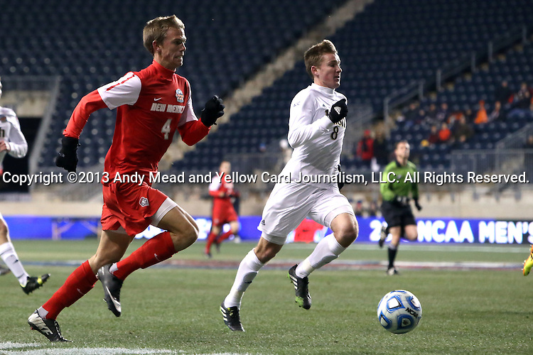 13 December 2013: New Mexico's Riley McGovern (4) and Notre Dame's Nick Besler (8) chase the ball. The University of Notre Dame Fighting Irish played the University of New Mexico Lobos at PPL Park in Chester, Pennsylvania in a 2013 NCAA Division I Men's College Cup semifinal match. Notre Dame won the game 2-0.
