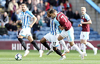 Huddersfield Town's Rajiv van La Parra shields the ball from Burnley's Johann Gudmundsson<br /> <br /> Photographer Rich Linley/CameraSport<br /> <br /> The Premier League - Burnley v Huddersfield Town - Saturday 6th October 2018 - Turf Moor - Burnley<br /> <br /> World Copyright &copy; 2018 CameraSport. All rights reserved. 43 Linden Ave. Countesthorpe. Leicester. England. LE8 5PG - Tel: +44 (0) 116 277 4147 - admin@camerasport.com - www.camerasport.com