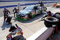 Oct. 11, 2009; Fontana, CA, USA; NASCAR Sprint Cup Series driver Denny Hamlin pits during the Pepsi 500 at Auto Club Speedway. Mandatory Credit: Mark J. Rebilas-