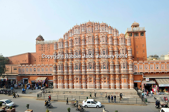 Hawa Mahal or Palace of the Winds was built in 1799 by Maharaja Pratap Singh and designed by Lal Chand Ustad in the form of the crown of Lord Krishna.Built of red and pink sandstone it has 953 small windows called jharokhas that are decorated with intricate latticework.The original intention of the lattice was to allow royal ladies to watch everyday life in the street below without being seen, since they had to observe strict purdah (face cover). The facade is part of the City Palace complex in the old part of Jaipur in Rajasthan,India.