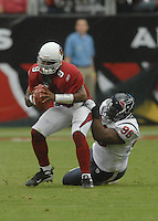 Aug 18, 2007; Glendale, AZ, USA; Arizona Cardinals quarterback Shane Boyd (9) gets sacked by Houston Texans defensive tackle Thomas Johnson (96) at University of Phoenix Stadium. Mandatory Credit: Mark J. Rebilas-US PRESSWIRE Copyright © 2007 Mark J. Rebilas