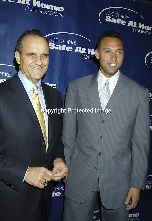 Joe Torre and Derek Jeter..at The  Joe Torre Safe at Home Foundation's 3rd Annual Gala on November 18, 2005 at The Pierre Hotel.The Foundation is dedicated to stemming domestic violence...Photo by Robin Platzer, Twin Images