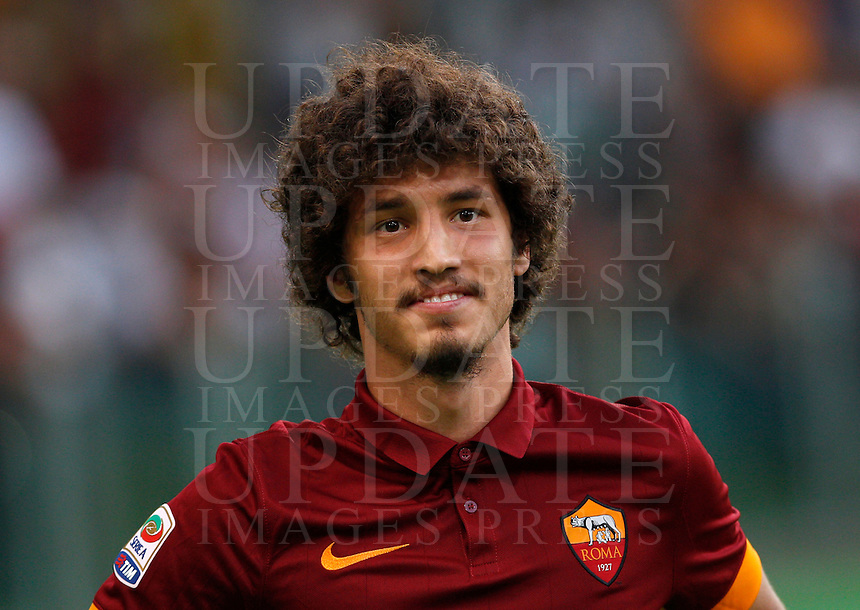 Calcio, amichevole Roma vs Fenerbahce. Roma, stadio Olimpico, 19 agosto 2014.<br /> AS Roma midfielder Salih Ucan, of Turkey, greets fans during the team's presentation, prior to the friendly match between AS Roma and Fenerbache at Rome's Olympic stadium, 19 August 2014.<br /> UPDATE IMAGES PRESS/Riccardo De Luca