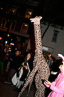 A giraffe makes its way up State Street during Freak Fest on Saturday during Freakfest 2015 on State Street in Madison, Wisconsin