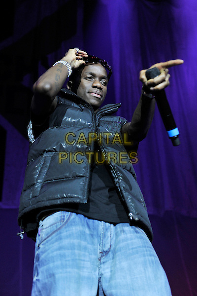 TINCHY STRYDER (Kwasi Danquah).Live at the O2 Arena, London, England, UK, 3rd February 2011..music concert live on stage concert gig  performing half length microphone  black puffa puffer bodywarmer jeans sunglasses lifting up finger pointing .CAP/MAR.© Martin Harris/Capital Pictures.