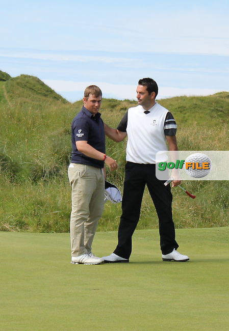 Gary Collins (Rosslare) &amp; Gary O' Flaherty (Cork) Shaking hands on the 15th green during Matchplay Round 3 of the South of Ireland Amateur Open Championship at LaHinch Golf Club on Saturday 25th July 2015.<br /> Picture:  Golffile | TJ Caffrey