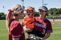 STANFORD, CA -- April 15, 2018. <br /> Hannah Howell, Alyssa Horeczko with fan after the Stanford Cardinal women's softball team loss to the Oregon State Beavers at the Smith Family Stadium 12-1.