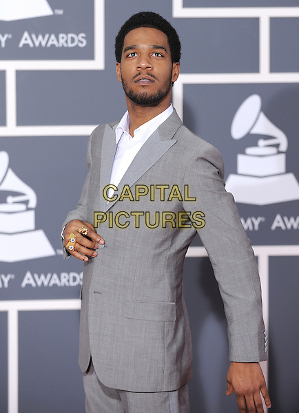 KID CUDI (Scott Ramon Seguro Mescudi).Arrivals at the 52nd Annual GRAMMY Awards held at The Staples Center in Los Angeles, California, USA..January 31st, 2010.grammys half length grey gray suit jacket beard facial hair.CAP/RKE/DVS.©DVS/RockinExposures/Capital Pictures