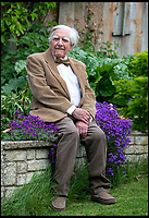 BNPS.co.uk (01202 558833)<br /> Pic: RogerArbon/BNPS<br /> <br /> A remarkable D-Day veteran is finishing off landscaping his garden - at the age of 101.<br /> <br /> Sub Lieutenant Roy Cooper, who served on board a Royal Navy minesweeper during the Allied invasion of Europe, first dug a 23ft by 13ft by 7ft pond in eight hour stints, laying 1,000 bricks in the process.<br /> <br /> He then fitted it with a filtration system and built a wooden footbridge above it from which he can admire his koi carp.<br /> <br /> Now, he is building a 8ft by 6ft wooden shed in the corner of the garden, and he is turning his garage into an annex.<br /> <br /> Roy, who lives in a detached house in Marnhull, Dorset, is thought to be the oldest surviving Royal Navy officer to take part in the invasion.