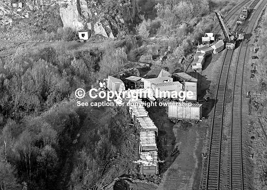 A crane moves in to clear the railway track at Goragh Wood, near Newry, N Ireland after a Provisional IRA-hijacked goods train derailed. 197511210740a<br />