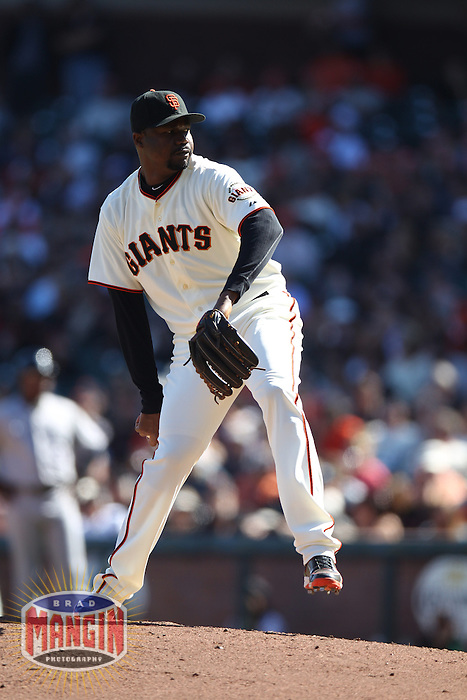 SAN FRANCISCO - SEPTEMBER 20:  Guillermo Mota of the San Francisco Giants pitches during the game against the Colorado Rockies at AT&T Park on September 20, 2012 in San Francisco, California. (Photo by Brad Mangin)