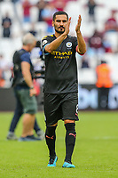 Ilkay Gundogan of Manchester City applauds the travelling fans after the Premier League match between West Ham United and Manchester City at the London Stadium, London, England on 10 August 2019. Photo by David Horn.