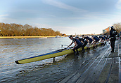 19.01.2014. River Thames, London, England. Oxford University Boat Club Trial VIIIs, Stubborn VIII John Redos [Bow], Tom Watson [2], Joseph Dawson [3], James Mountain [4], Karl Hudspith [5], Nicholas Hazell [6], Sam O'Connor [7], Constantine Louloudis [Stroke], Sophie Shawdon [Cox] remove the boat. The Trial serves as part of the selection process to determine who will represent Oxford University in the 160th running of the University Boat Race on April 6th 2014. The trial for the two eights, named Persistent and Stubborn is the only occasion during the season that the squad members can race side-by-side over the full four and a quarter miles of the Championship Course between Putney and Mortlake in a simulation of The BNY Mellon Boat Race.