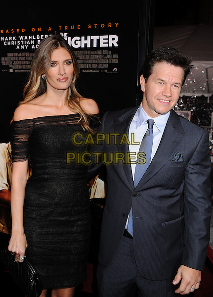 "RHEA DURHAM & MARK WAHLBERG .arriving at the Los Angeles premiere of ""The Fighter"" at Grauman's Chinese Theater in Hollywood, California, USA, December 6th, 2010..half length black off the shoulder dress hand in pocket suit couple married couple husband wife blue shirt tie  .CAP/ROT/TM.©TM/Roth Stock/Capital Pictures"
