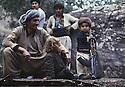 Iran 1979.A little kid with the kalachnikof of his father near the headquarter of KDPI.Iran 1979.Un tout-petit posant avec la kalachnikof de son pere au quartier general du PDKI