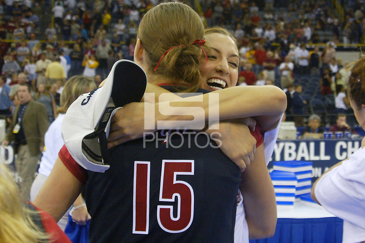 18 December 2004: Stanford Cardinal Jennifer Wilson hugs Michelle Mellard during Stanford's  30-23, 30-27, 30-21 victory over Minnesota in the 2004 NCAA Women's Volleyball National Championships in Long Beach, CA. Stanford won their sixth women's volleyball title in school history.<br />Photo credit mandatory: David Gonzales