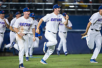 Tyler Dyson (18) of the Florida Gators rushes the field to celebrate the walk-off win over the Wake Forest Demon Deacons in Game One of the Gainesville Super Regional of the 2017 College World Series at Alfred McKethan Stadium at Perry Field on June 10, 2017 in Gainesville, Florida.  The Gators defeated the Demon Deacons 2-1 in 11 innings.  (Brian Westerholt/Four Seam Images)