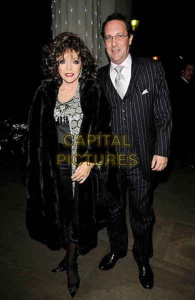 JOAN COLLINS & PERCY GIBSON .At the Livedrive new online file backup software launch, Lanesborough Hotel, London, England, UK, .1st December 2009..full length black  grey gray pinstripe suit waistcoat couple married husband wife fur coat silver beaded sparkly make-up tie .CAP/CAN.©Can Nguyen/Capital Pictures.